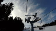 Ski lift moves up to the top of the mountain.