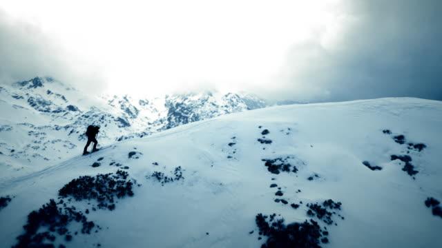 AERIAL Ski tourer on mountain ridge
