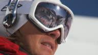 CU ZO SLO MO Skier in skiwear getting ready to ski / Alta, Snowbird, Utah, USA