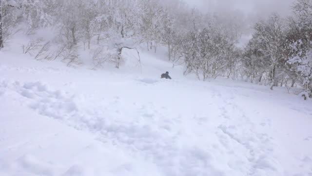 Skier skiing in fresh powder on a mountain.