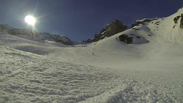 Skier spraying snow at camera in slow motion