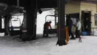 Skiers getting on the ski lift