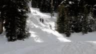 Skiers Hike Snowy Mountainside