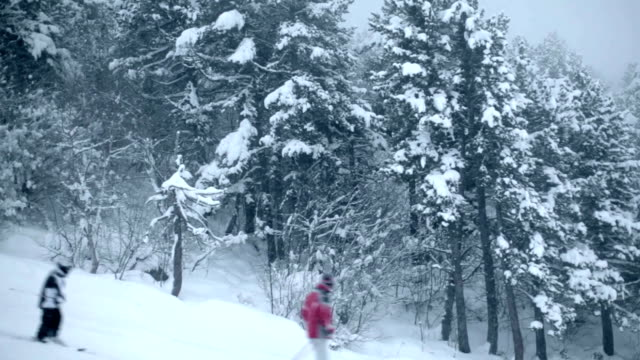 Skiers pass in front of the camera