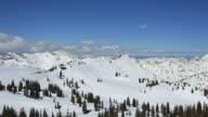 PAN Skiers racing down winter mountain landscape / Alta, Utah, United States
