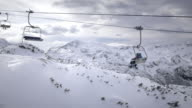 AERIAL Skiers riding a chairlift and enjoying wonderful winter scenery
