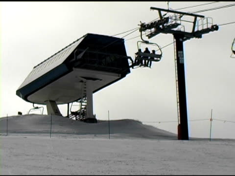 skiing chairlift unloading at top of mountain