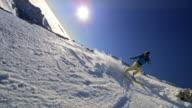 SLO MO Skiing down the mountain in sunshine
