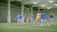Skillful female soccer player scoring impressive goal