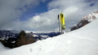 Skis Standing in Snow on Mountain Top PAN