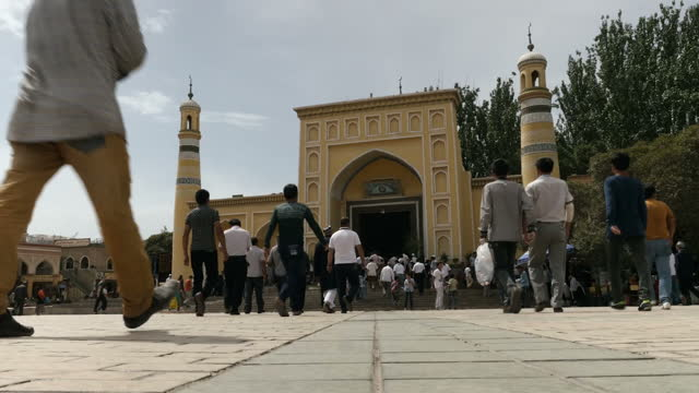 Sky News gains rare access to China's far western Xinjiang Province next to Afghanistan/Pakistan Shows exterior wide shot of men going to worship in...