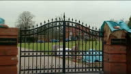 Sky Sports sack Andy Gray over sexist comments Warwickshire EXT General view of Andy Gray's house with entrance gates in foreground Close shot of...