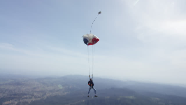 skydiver with laptop opens his parachute