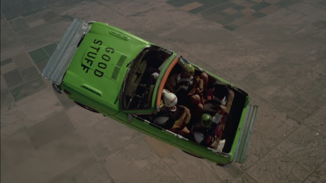 Skydiving with a green car