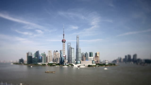 Skyline and modern buildings of shanghai at riverbank, real time.