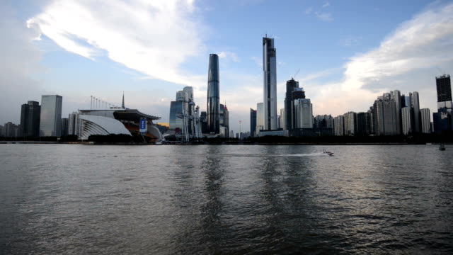 Skyline and modern office buildings of Guangzhou at riverside,real time.