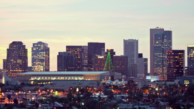 WS T/L Skyline of downtown Phoenix with convention center at dusk / Phoenix, Arizona, USA