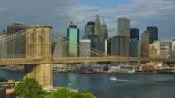 T/L WS Skyline of lower Manhattan with Brooklyn Bridge in foreground, New York City, New York, USA