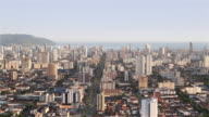 'WS Skyline view of city of Santos and ships awaiting entry to port / Santos, Brazil'