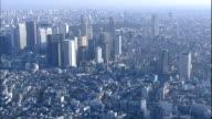 Skyscrapers tower over surrounding buildings in Tokyo, Japan.