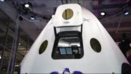 A sleek white gumdrop shaped space capsule that aims to carry up to seven astronauts to the International Space Station and return to land anywhere...