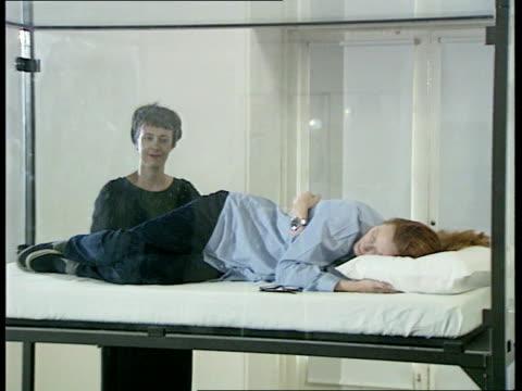 Sleeping actress art exhibit NAO London Kensington Serpentine Gallery CMS Artist Cornelia Parker walks around glass case inside which actress Tilda...
