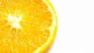 Slice of fresh orange isolated.