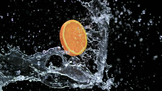 SLO MO Slice of orange in a water splash