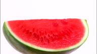 MS Slice of watermelon rotating against white background / Orem, Utah, USA