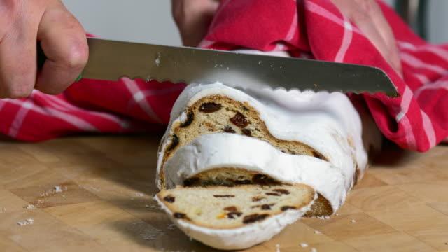 Slicing a Christstollen (Christmas Stollen) Fruit Cake