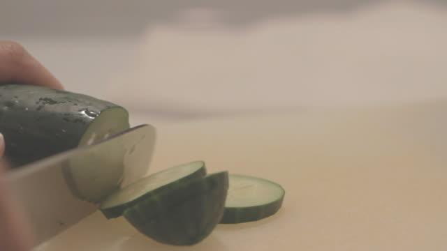 Slicing a cucumber