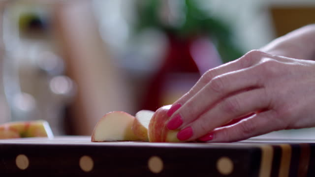 Slicing Apples on a cutting board