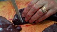 Slicing calf liver