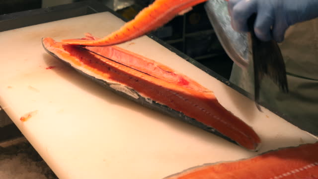 Slicing fresh salmon