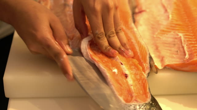 slicing salmon