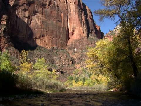 Slickrock wall above stream