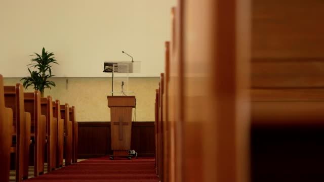 Slider shot revealing church pulpit