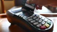 Sliding card through POS terminal and entering amount