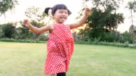 Slo Mo Child running in the park