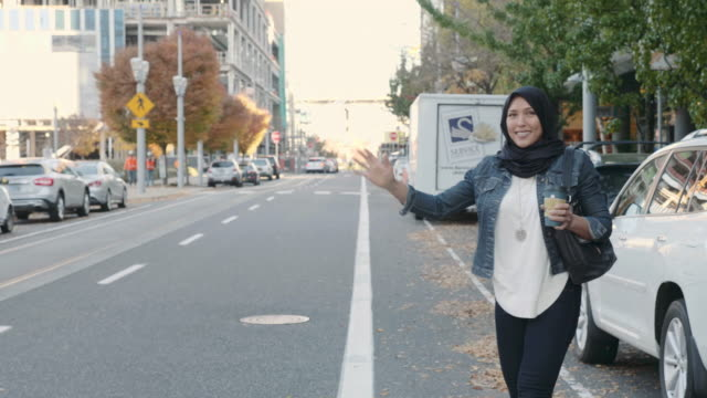 Slo Mo: Woman of Middle Eastern Descent Hailing a Taxi