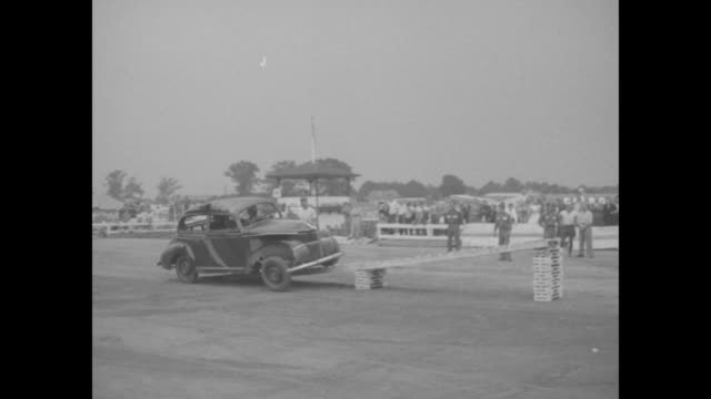 VS slomo drivers in 1930s cars drive with one side of car on ramp other not so as to flip the cars many of these stunts end up with the car back on...