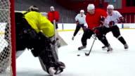 HD: Slo-Mo Shot of Ice Hockey Playersin the Scoring Action