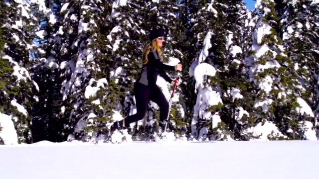 HD Slo-Mo: Shot of Young Women Ski Touring