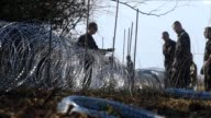 Slovenian soldiers erected razor wire along the border with fellow EU member Croatia on Thursday in a move the government said would help it better...