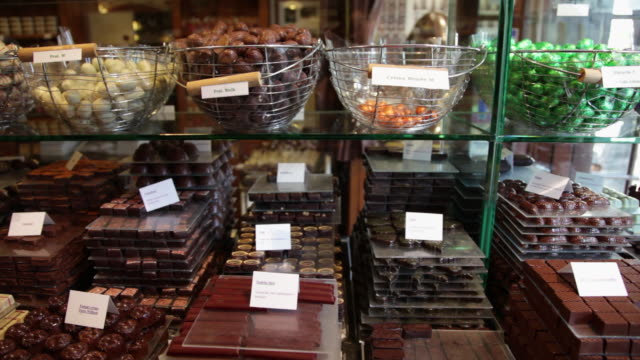 Slow dolly move across chocolate in shop in Bruges, Belgium