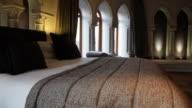 Slow dolly move inside hotel room called Patershol in Mechelen, Belgium