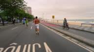 RIO DE JANEIRO, BRAZIL - JUNE 23: Slow dolly shot of people, Ipanema Beach on Jun 23, 2013 in Rio