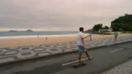 RIO DE JANEIRO, BRAZIL - JUNE 23: Slow dolly shot of skateboarders at Ipanema June 23, 2013 in Rio