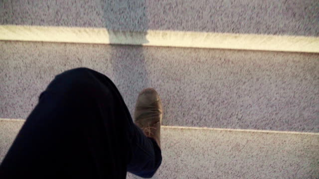Slow mo: POV man foot on a stairs