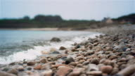 CU, Slow Motion 75FPS, Shingle beach and waves, cloudy sky, tilt-shift lens